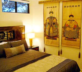 Luxurious bedroom is furnished with a French/Oriental theme